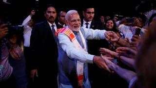 Indian Prime Minister Narendra Modi greets attendees at the Peace through Yoga meeting in Buenos Aires, Argentina, November 29, 2018