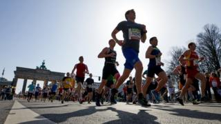 Runners close to Brandenburg gate at Sunday's half-marathon in Berlin