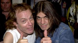 AC/DC band members Angus Young, l(left) and Malcolm Young (15 September 2000)