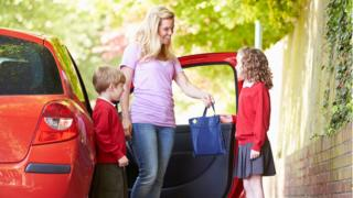 Children being driven to school