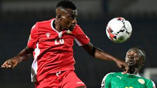 Kenya's midfielder Philemon Otieno (L) heads the ball next to Senegal's forward Sadio Mane during the 2019 Africa Cup of Nations (CAN) Group C football match between Kenya and Senegal at the 30 June Stadium in the Egyptian capital Cairo on July 1, 2019.