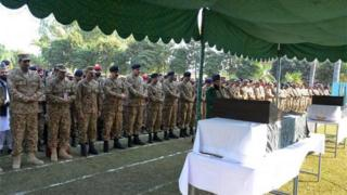 Pakistani army chief Raheel Sharif (4L) and military officials offer funeral prayers for soldiers who were killed in cross-border firing at the Line of Control (LoC) in Bhimber sector, in Jhelum some 120 kms south of Islamabad.