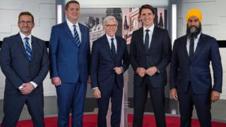 L-R: Yves-Francois Blanchet, Andrew Scheer, TVA network host Pierre Bruneau, Justin Trudeau, Jagmeet Singh