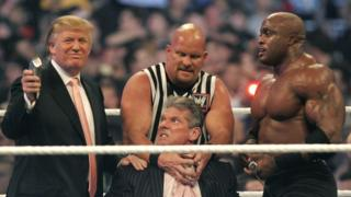 Donald Trump prepares to shave the head of World Wrestling Entertainment chairman Vince McMahon (centre, seated), during WWE's Wrestlemania in April 2007. Footage from the event was altered and showed up on Reddit, and was later tweeted by Trump