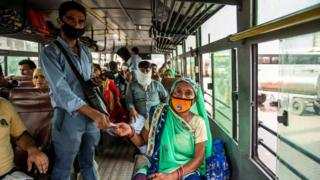 sports A bus conductor issues tickets to a female passenger in Uttar Pradesh.