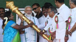 Members of Bharatiya Janata Party (BJP) give a golden scepter to Indian Prime Minister Narendra Modi (C) during a National Democratic Alliance (NDA) rally in Chennai on March 6, 2019.