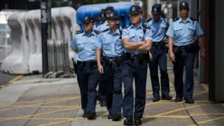 Police patrol a security area where Chinese state leader Zhang Dejiang will reside and deliver a speech during his 3-day visit in Hong Kong, China, 16 May 2016