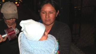 Maribel Musaja carrying Mateo in Arequipa, Peru