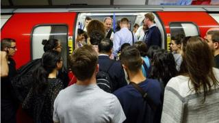 passengers getting on a tube train