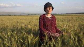 Shani Taragin, 45, a women's health and Jewish law teacher, in a wheat field at the Hula Valley in the Upper Galilee in northern Israel during the Passover holiday. (Photo by Heidi Levine for The BBC).