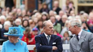 Queen Elizabeth II, the Duke of Edinburgh and the Prince of Wales, during a visit to Poundbury, a new urban development on the edge of Dorchester