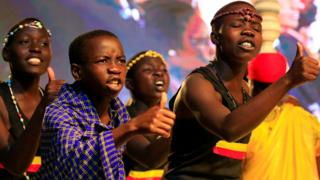 "Young people living in Uganda as refugees perform a song during refugees solidarity summit held in Uganda""s capital Kampala June 23, 2017."