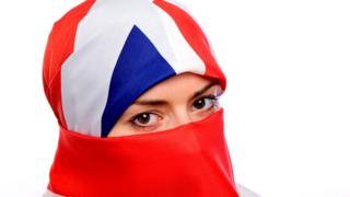 Woman wearing a union flag as a headscarf