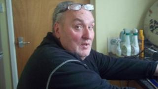 Jim Hughes was found dead in a flat on the 14th floor of the tower on Sunday night