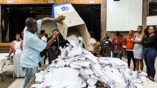 An Independent Electoral Officer (IEC) opens a ballot box as counting begins at the Addington Primary School after voting ended at the sixth national general elections in Durban, on May 8, 2019.