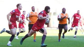 Scarlets full-back Leigh Halfpenny scored a try before limping off late in the first half