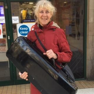 Fiona West with her viola and case