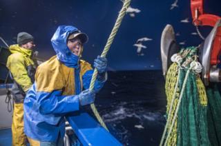 Two fishermen on board the Guardian Angell boat in the Shetlands