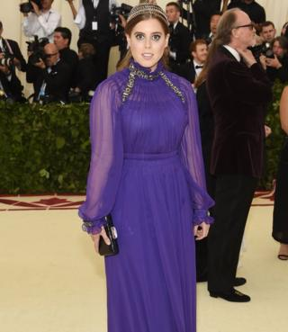 Princess Beatrice wears a floor-length purple gown at the New York Met Gala.