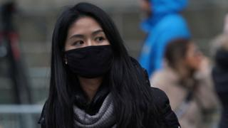 Woman in NYC wearing mask