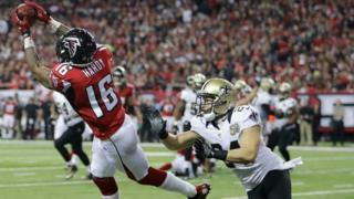 Atlanta Falcons wide receiver Justin Hardy (16) makes a touchdown catch against New Orleans Saints cornerback Sterling Moore (24) during the first half of an NFL football game, Sunday, Jan. 1, 2017, in Atlanta.