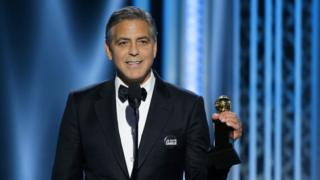 George Clooney with his Golden Globe Award