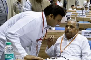 Chief Minister Akhilesh Yadav (left) with father Mulayam Singh Yadav