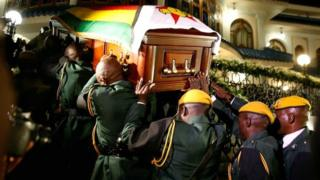 The body of former Zimbabwean President Robert Mugabe arrives at the Blue Roof, his residence in Borrowdale, Harare, Zimbabwe, on 11 September 2019