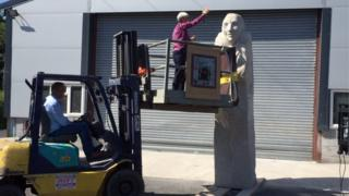 The Right Reverend Joanna Penberthy was lifted on a forklift to bless the statue