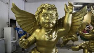 A golden cherub at a samba school