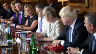 Theresa May chairs a cabinet meeting at Chequers