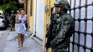Marines stand guard in a street in Acapulco