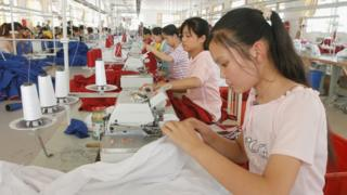 Women sew in a factory in China