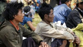 Refugees fleeing the conflict in the China-Myanmar border town of Laukkai await transportation, 7 March 2017