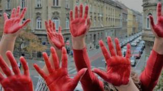 Hands painted in red