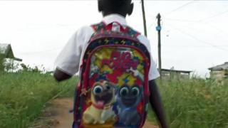 A boy going to an illegal school in Douala, Cameroon