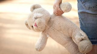 A generic image of a child holding a soft toy