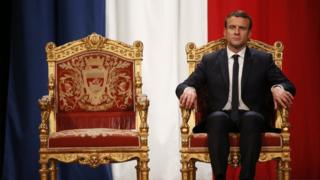 French President Emmanuel Macron listens as Paris Mayor Anne Hidalgo delivers her speech on his inauguration day, 14 May
