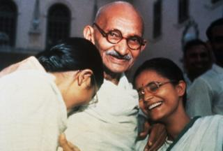 Mahatma Ghandi enjoys a laugh with granddaughters Manu (left) and Abha (right) at Birla House in New Delhi.