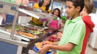 children getting school meals