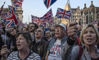Pro-Brexit demonstrators gather in Parliament Square to listen to Nigel Farage speak