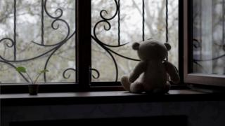 teddy bear at window
