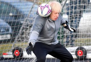 Prime Minister Boris Johnson tried to save a shot whilst in a football goal