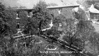 The front of Doncaster Sand House, with sunken garden
