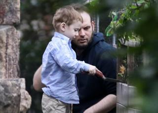 boyle plays with his son after their release