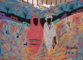 A mural of a man and woman on a wall in Khartoum, Sudan