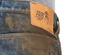 The mud-caked jeans being marketed by Nordstrom