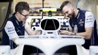 Jack and Chris working on Lance Stroll's F1 car