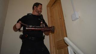 Police officer with a battering ram