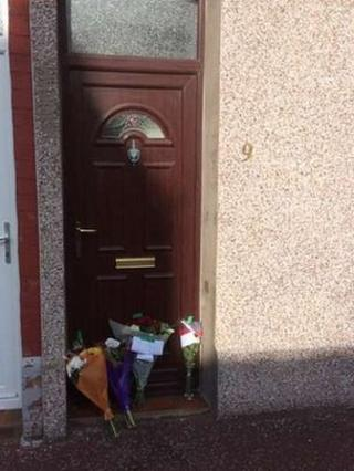 Floral tributes at scene of Barrow house death